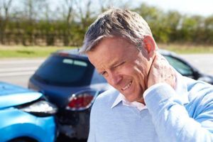 A person with pain after refusing treatment after a car accident